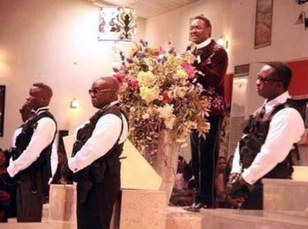 pastor chris okotie surrounded by guards